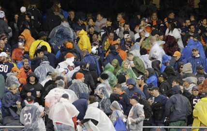 Fans begin to leave their seats as a severe storm blows through Soldier Field in Chicago during an NFL football game between the Chicago Bears and the Baltimore Ravens. Play was suspended in the game.