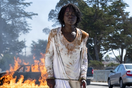 "This image released by Universal Pictures shows Lupita Nyong'o in a scene from ""Us,"" written, produced and directed by Jordan Peele."