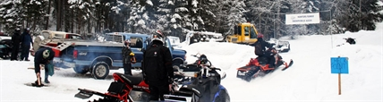 Members of the Hunters Range Snowmobile Association gather at one of the club's trail heads.