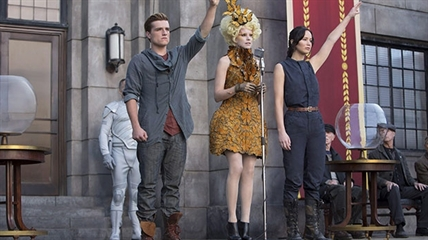 Josh Hutcherson as Peeta Mellark (from left to right) Elizabeth Banks as Effie Trinket and Jennifer Lawrence as Katniss Everdeen in a scene from 'The Hunger Games: Catching Fire'.