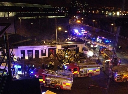 Picture taken with permission from Jan Hollands Twitter feed JanHollands@Janney_h of the helicopter crash at the Clutha Bar in Glasgow Friday Nov. 29, 2013.