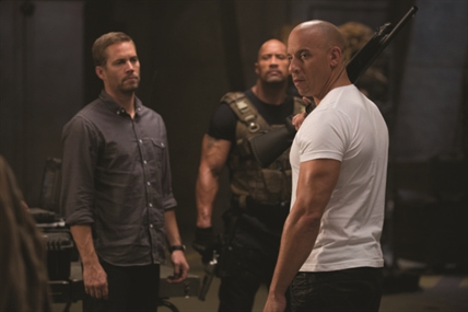 Paul Walker (left), Dwayne Johnson and Vin Diesel in Fast and Furious 6.