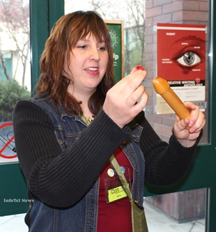 Opt Penticton administration staffer Kathy Hiebert gives a condom roll-on demonstration at the Okanagan College Penticton campus.