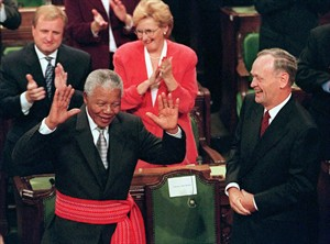 South African President Nelson Mandela is given a standing ovation in the House of Commons on Parliament Hill in Ottawa Thursday Sept, 24, 1998. The former South African president, who spent much of 2013 in and out of the hospital, died Thursday, Dec. 5, 2013 at age 95.