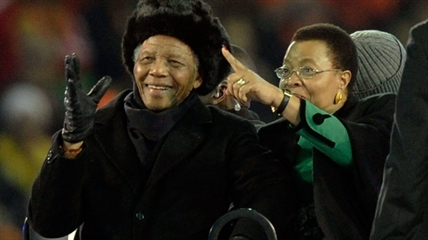 Former South African President Nelson Mandela, left, with his wife Graca Machel, right, attends the final of the FIFA World Cup Soccer Tournament in Johannesburg in this file photo taken July 11, 2010 -- Mandela's last public appearance.