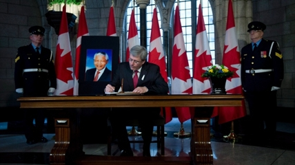 Canadian Prime Minister Stephen Harper signs a Book of Condolence after the passing of Nelson Mandela Friday December 6, 2013 on Parliament Hill in Ottawa.