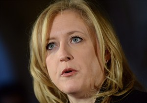 Transport Minister Lisa Raitt makes an announcement on Parliament Hill in Ottawa on Wednesday, Nov. 20, 2013. Raitt is defending Canada Post's decision to phase out urban mail delivery over the next five years while hiking the price of stamps.