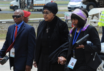 Winnie Madikizela-Mandela, Nelson Mandela's former wife, arrives with Ndileka Mandela, right, at Mthatha Airport in Mthatha, South Africa, Saturday, Dec. 14, 2013.
