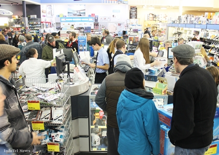 A thick crowd gathers around this employee cash register fortress at London Drugs at the Cherry Lane Mall today.