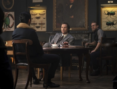 "This image released by STXfilms shows, from left, Henry Golding, Matthew McConaughey and Charlie Hunnam in a scene from ""The Gentlemen."""