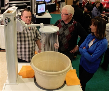 The ThunderHead shower was a bit of a hit at the Canadian Home Builders' Association South Okanagan 18th annual Home and Renovation Show on Saturday. Company rep James Eaton shows off the unit to prospective buyers Al Rycroft and Betty Rycroft of Penticton.