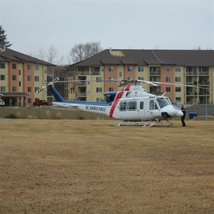 A BC Air Ambulance helicopter lands in Oliver to airlift the victims of an an Osoyoos house fire on Friday, Jan. 18, 2014. The couple, who were badly burned, were taken by ambulance to hospital in Oliver before they were airlifted, one to Kelowna and one to Vancouver.