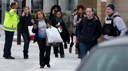 Shoppers are evacuated by police after a shooting at The Mall in Columbia in Columbia, Md. on Saturday, Jan. 25, 2014.