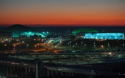 The Bolshoi Ice Dome, background center, Iceberg skating arena, right, and the Fisht Olympic Stadium, left, are illuminated at night in Sochi, Russia.