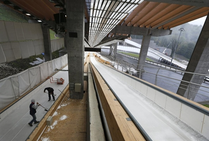 Workers are busy operating in the Sanki Sliding Center in Krasnaya Polyana outside the Black Sea resort of Sochi, Russia.