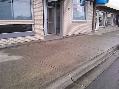 The sidewalk in the 100 block of Highway 33 where Christopher Ausman's, 32, body was found on Saturday, Jan. 25, 2014 has been power washed to removed the blood.