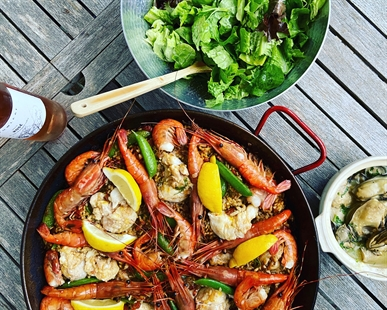 A delicious Paella featuring beautiful sustainable Ocean Wise seafood paired with B.C. Rosé is a perfect summer dish.