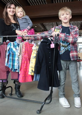 Janet Skolka, her daughter Jersey and her son Ryder, show off some of the high-end children's clothing that she sells at a discount price through her online business, at www.JillyBoBilly.com. The three were at a Dragons' Den audition earlier today in Penticton.