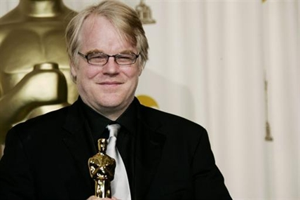 In a Sunday, March 5, 2006 Philip Seymour Hoffman poses with the Oscar he won for best actor for his work in