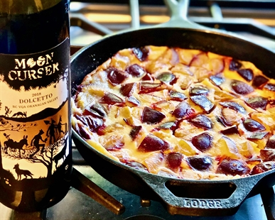 Plum Clafoutis is best made in a cast iron pan. Pair it with Moon Curser Vineyards chilled Dolcetto like it is in my B.C. Wine Lover's Cookbook.