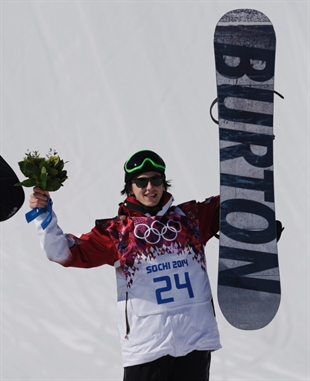 Canada's Mark McMorris celebrates on the podium after winning the bronze medal in the men's snowboard slopestyle final at the Rosa Khutor Extreme Park, at the 2014 Winter Olympics in Krasnaya Polyana, Russia, Saturday, Feb. 8, 2014.
