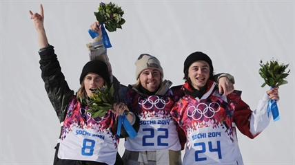 United States' Sage Kotsenburg, centre, celebrates with Norway's Staale Sandbech, left, and Canada's Mark McMorris after Kotsenburg won the men's snowboard slopestyle final at the Rosa Khutor Extreme Park, at the 2014 Winter Olympics in Krasnaya Polyana, Russia, Saturday, Feb. 8, 2014.