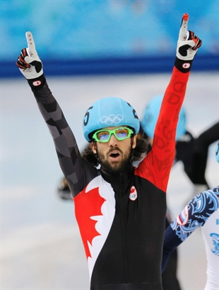 Charles Hamelin of Canada celebrates after winning the men's 1500m short track speedskating final at the Iceberg Skating Palace during the 2014 Winter Olympics, Monday, Feb. 10, 2014, in Sochi, Russia.