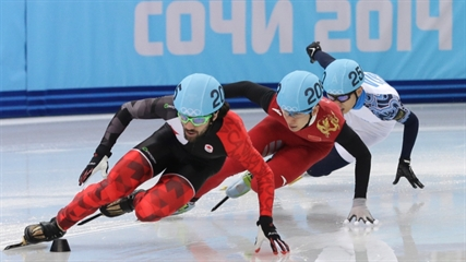 Charles Hamelin of Canada, left, Han Tianyu of China, centre, and Victor An of Russia compete in a men's 1500m short track speedskating final at the Iceberg Skating Palace during the 2014 Winter Olympics in Sochi, Monday, Feb. 10, 2014.