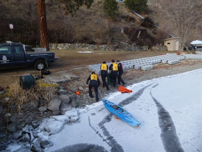 Rescuers get a deer to shore after it was stuck on the ice on Okanagan Lake on Sunday, Feb. 9, 2014.