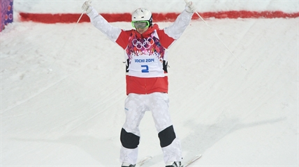 Mikael Kingsbury of Canada skis during the second finals run in the men's moguls freestyle skiing event at the Sochi Winter Olympics in Krasnaya Polyana, Russia, Monday, Feb. 10, 2014.