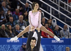 Canada's Meagan Duhamel and Eric Radford perform their short program during the pairs figure skating competition at the Sochi Winter Olympics Tuesday, February 11, 2014 in Sochi.