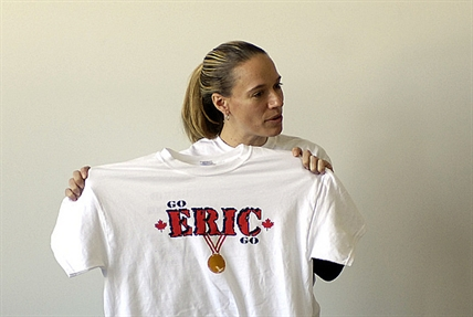 RMS teacher Melissa Harris with one of the hundreds of t-shirts her students designed to honour Eric Neilson.
