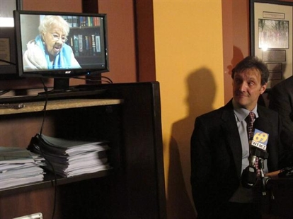 Ciivil liberties lawyer Witold J. Walczak looks up at a plaintiff against Pennsylvania's voter ID law.
