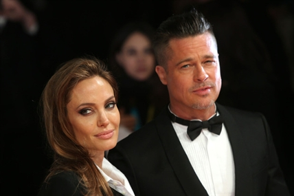 Angelina Jolie and Brad Pitt pose for photographers on the red carpet at the Bafta Awards in London.