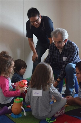Education manager Kevin Ned joins elders and children at the language nest.