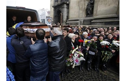 People carry the coffin in Lviv, western Ukraine, Saturday, Feb. 22, 2014.