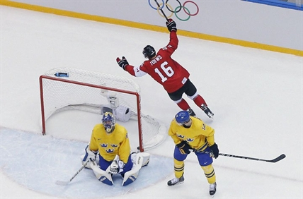 Canada forward Jonathan Toews reacts after making a goal during the first period of the men's gold medal ice hockey game against Sweden at the 2014 Winter Olympics, Sunday, Feb. 23, 2014, in Sochi, Russia.