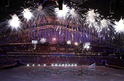 Fireworks light up the arena as artists make a formation in the shape of the Olympic Rings during the closing ceremony of the 2014 Winter Olympics, Sunday, Feb. 23, 2014, in Sochi, Russia.