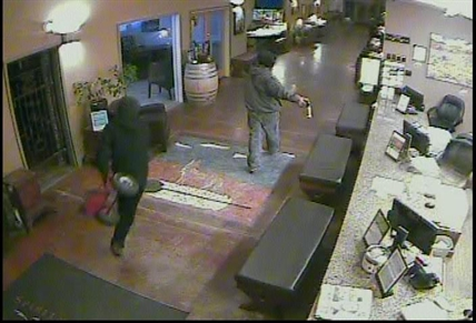 Second suspect enters lobby with trolly.