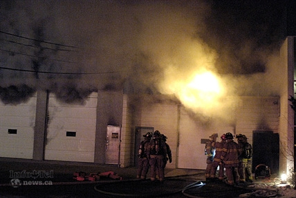 Firefighters were called to Northern Lite Manufacturing Ltd. at 322 Totem Ave. on Wednesday, Feb. 26, 2014 and found heavy smoke. They hit it hard with up to 40 firefighters but once the blaze got to the roof, its collapse was inevitable.