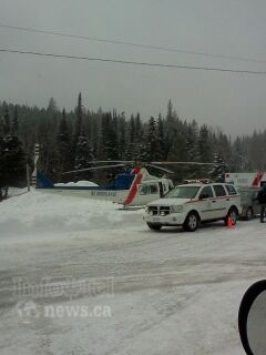 The B.C. Ambulance Service air ambulance landed in the parking lot at Crystal Mountain Resort to transport a patient in critical condition to Kelowna General Hospital on Saturday, Mar. 1, 2014.