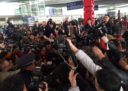 In this photo released by China's Xinhua News Agency, reporters crowd at Terminal 3 of Beijing Capital International Airport in Beijing, China Saturday, March 8, 2014 following a report that a Malaysia Airlines Boeing 777-200 lost contact on a flight from Kuala Lumpur to Beijing.