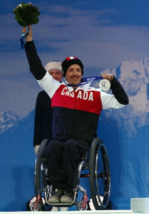 Vernon's Josh Dueck celebrates his silver medal in the mens sitting skiing downhill during the 2014 Paralympic Games on Saturday, Mar. 8, 2014.