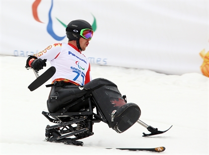 Vernon's Josh Dueck competes in the men's super combined sit ski event on March 14, 2014 at the 2014 Sochi Paralympic Winter Games in Sochi. Dueck went on to win the gold medal.