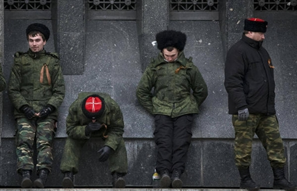 Cossacks guard the regional parliament building during the Crimean referendum in Simferopol, Ukraine, Sunday, March 16, 2014.
