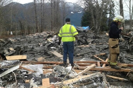 Fire fighters searching for victims in the homes hit by a mudslide in Snohomish Country on Saturday, March 22, 2014.