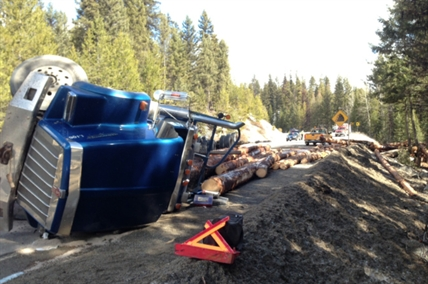 A logging truck flips and skids onto oncoming lane on Highway 33 her Beaverdell Monday morning.