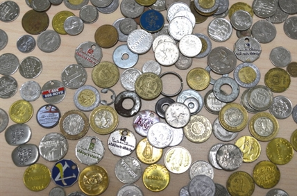 Coins from around the world, as well as washers, slugs, and tokens, are found in the city's parking meters.
