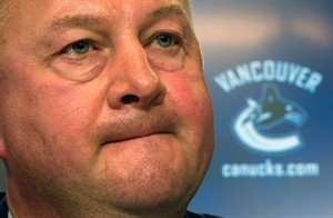 FILE - In this May 22, 2013 file photo, Vancouver Canucks president and general manager Mike Gillis addresses reporters in Vancouver, British Columbia. The Canucks have fired Gillis, Tuesday, April 8, 2014, a day after being eliminated from playoff contention.