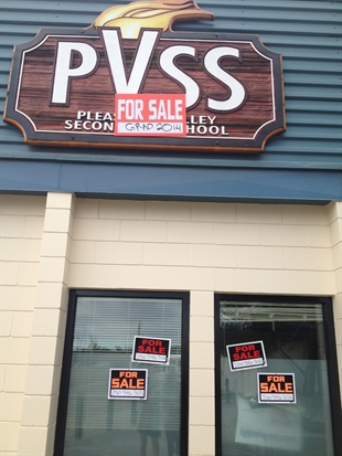 Armstrong grads covered their school with For Sale signs this week in a well planned prank.